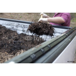 A landscaper getting mulch out from the back of a pickup truck 64239