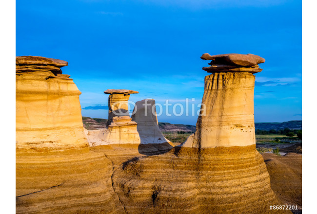 Art painting Hoodoos bathed in the warm light of a summer sunset at Drumheller Alberta Canada. 64239