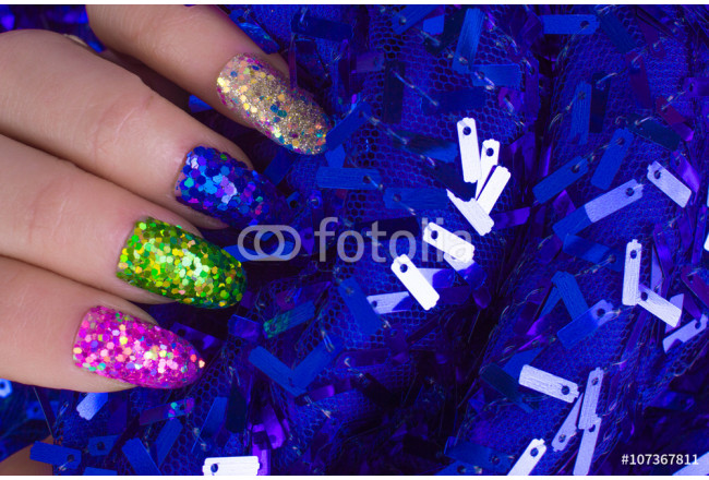Fashionable Stylish Colorful nails and nail polish on a bright background. Manicure nail painting. Beauty hands. 64239
