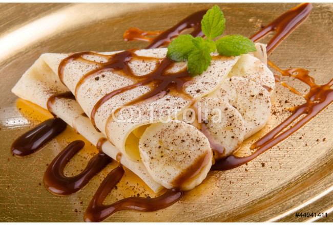 crepe with banana slices and sauce 64239