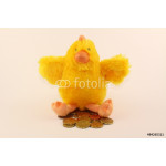 Gold (money) laying plush hen doll on a white background 64239