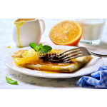Crepes with chocolate filling and orange syrup. 64239