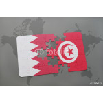 puzzle with the national flag of bahrain and tunisia on a world map background. 64239