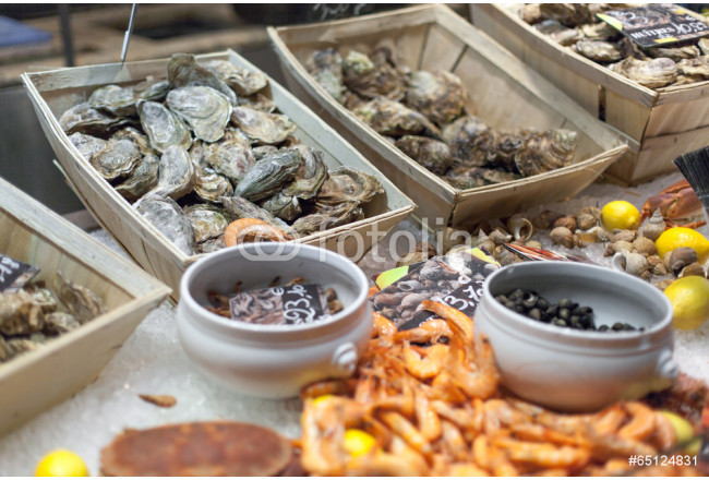 Oysters and shrimps for sale in fish market 64239