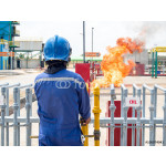 Firefighter, fire fighter,  firemen, fireman, ignite fire by discharge oil through pipeline for preparing fire during conflagration preventive extinguisher training, Safety concept. 64239