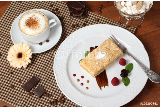 Obraz nowoczesny Piece of napoleon cake with cup of cappuccino. 64239