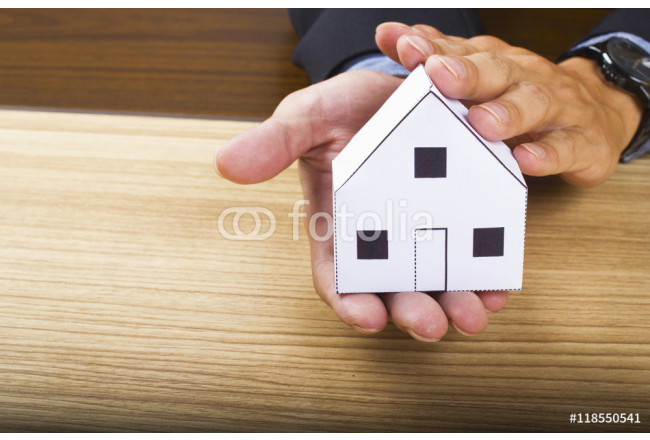 Businessman holding paper home model. Loan concept 64239