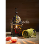 Arab lamp whit a candle in the hammam 64239