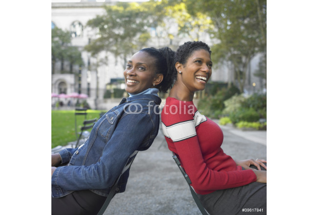 Friends sitting in park 64239