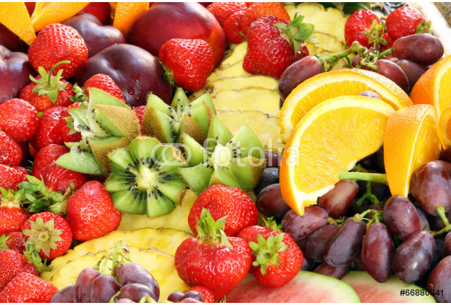 Healthy fruit breakfast with strawberry grape pineapple and kiwi 64239