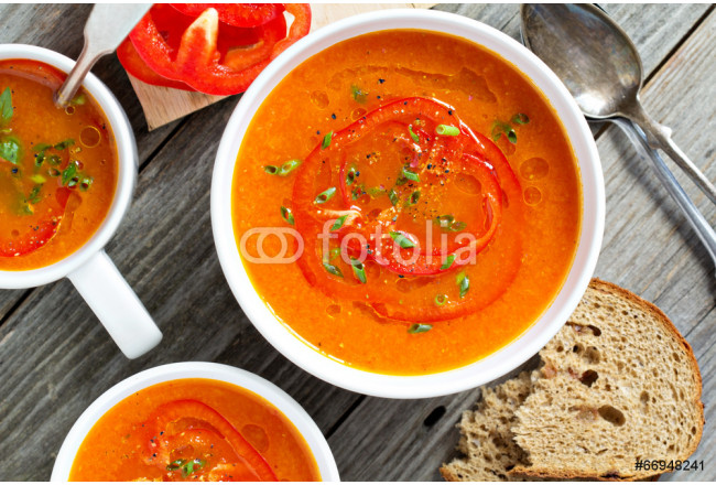 Roasted red pepper soup in white bowl 64239