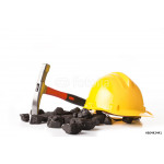 Yellow helmet with mining pickax and loose lumps of black coal 64239