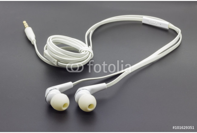 White earphones on the black isolated background 64239
