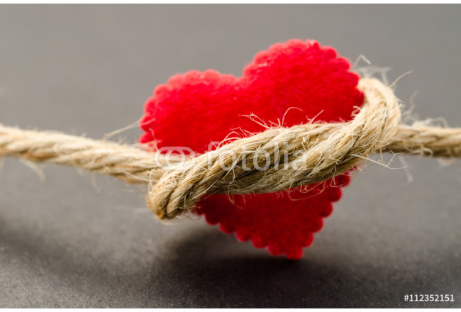 Red heart with a bundle rope. 64239