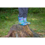 Legs boy in rubber boots standing on a tree stump 64239