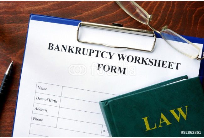 Bankruptcy worksheet form on a wooden table. 64239