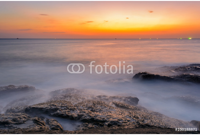 Long exposure seascape during blue hour sunset with rocks as foreground. Nature composition 64239