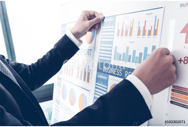 Businessman analyzing investment charts. Accounting 64239