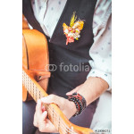 close up finger of guitarist while playing guitar in the outdoor garden 64239