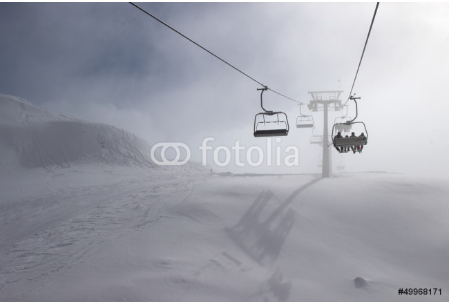 Ski chairlift on foggy day 64239