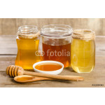 three jars,the bowl, the spoon with a honey on wooden background 64239