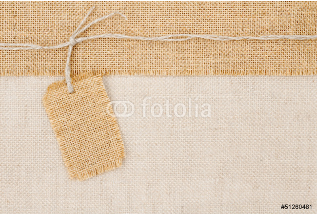 Sackcloth tag pricing over burlap fabric texture 64239