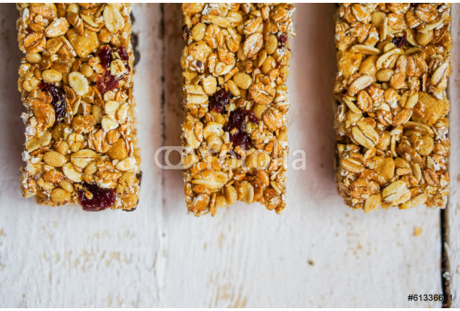 Granola bars on wooden background 64239