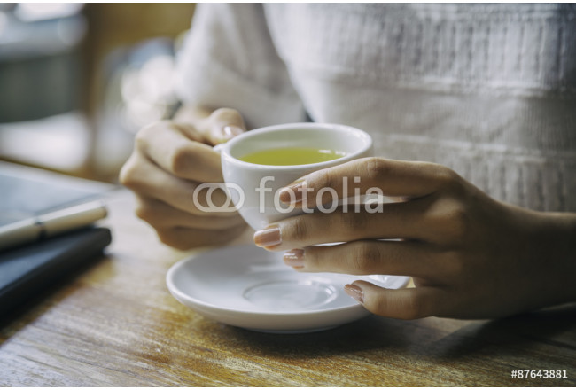 Painting close up of woman holding a cup of tea  64239