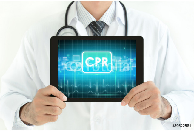 Doctor holding tablet pc with CPR sign on screen 64239