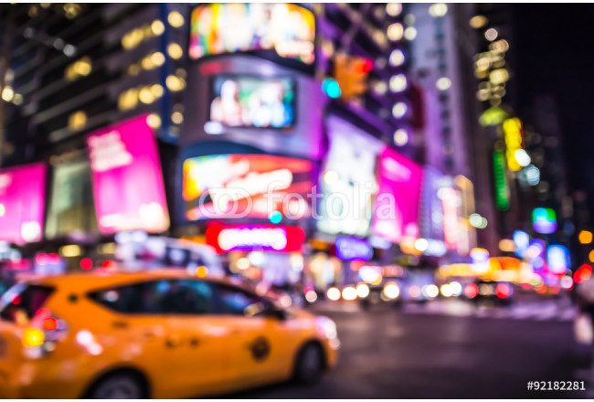 Defocused blur of Times Square in New York City with lights at night and taxi cab 64239