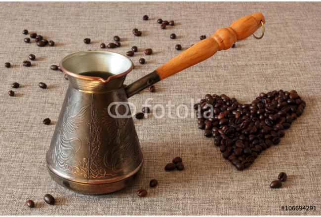 Coffee Turk and coffee beans in the shape of a heart on sack cloth background. 64239