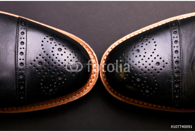 black oxford shoes with shoelace top view closeup 64239