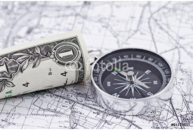 one-dollar bill and a compass lying on a map 64239