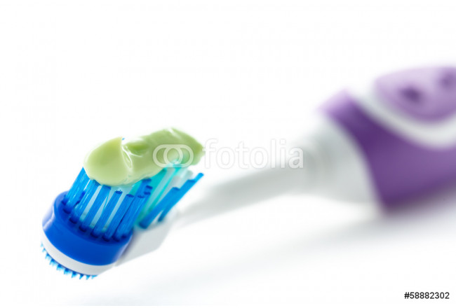 Electric toothbrush with toothpaste 64239