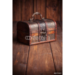 closed treasure chest standing on wooden table 64239