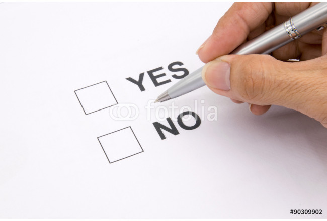 Man hand with pen over document, select Yes or No. 64239