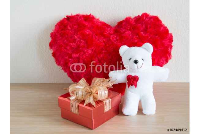 Fluffy red heart and happy white teddy bear and red gift on wooden background 64239