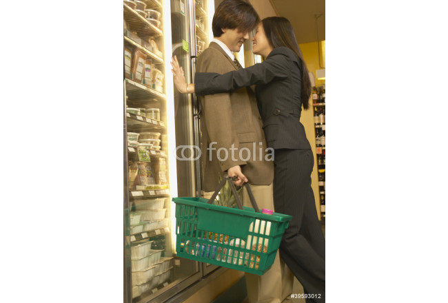 Asian couple hugging at grocery store 64239