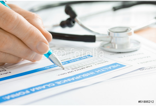 Doctor with Medical Claim Form and Stethoscope 64239