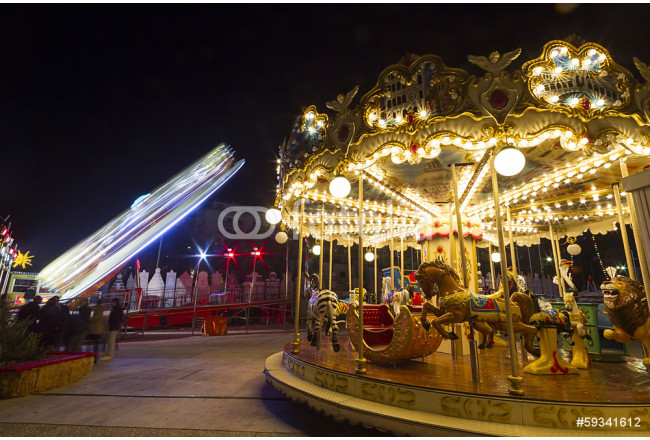 Quadro contemporaneo Luna park carousel in a public outdoor area 64239