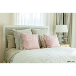 luxury bedroom interior with pink pillows and reading lamp on be 64239