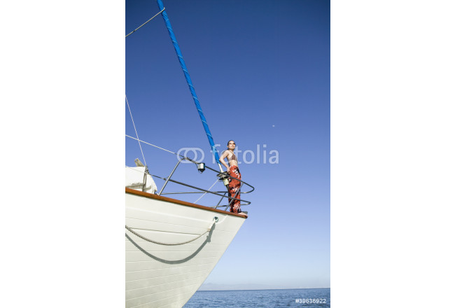 Toile déco Asian woman standing on bow of sailboat 64239