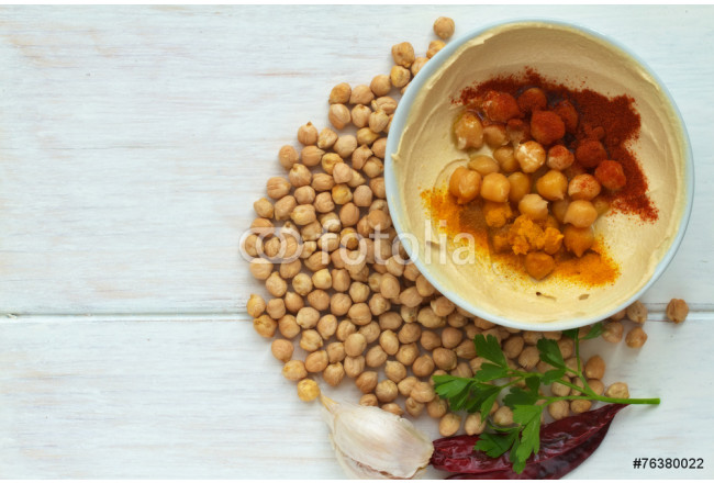 Hummus dish on a vintage wooden background 64239