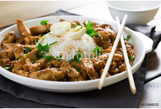 Fried chicken in soy sauce with sesame and rice 64239