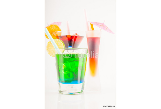 Colorful cocktail decorated with fruit, colorful umbrella, ice cubes, party night 64239