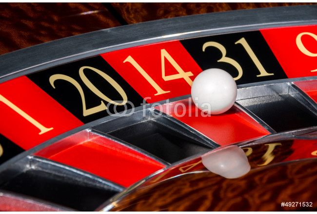Classic casino roulette wheel with red sector fourteen 14 64239