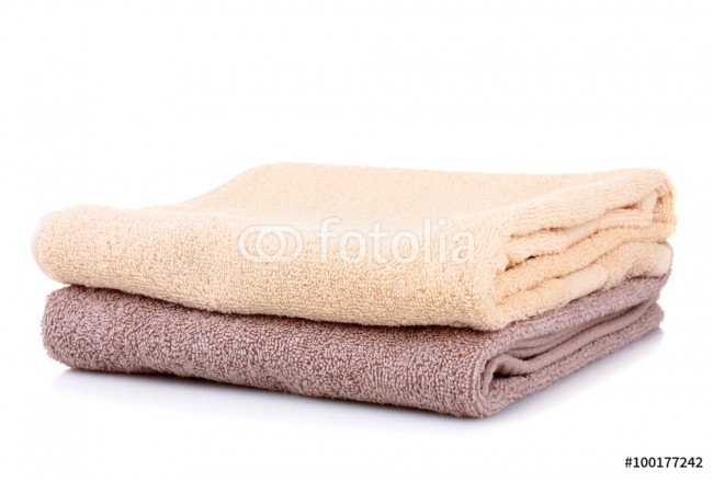 folded clean towels on a white background isolated 64239