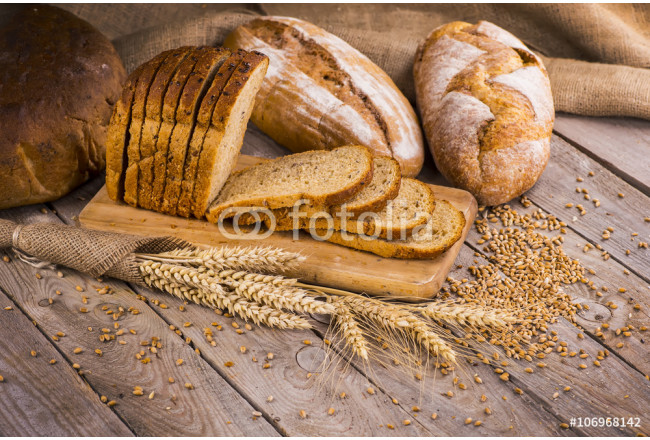 fresh bread and wheat on the wooden 64239
