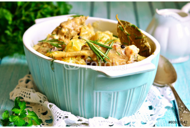 Rabbit stewed with potato in a cream sauce. 64239