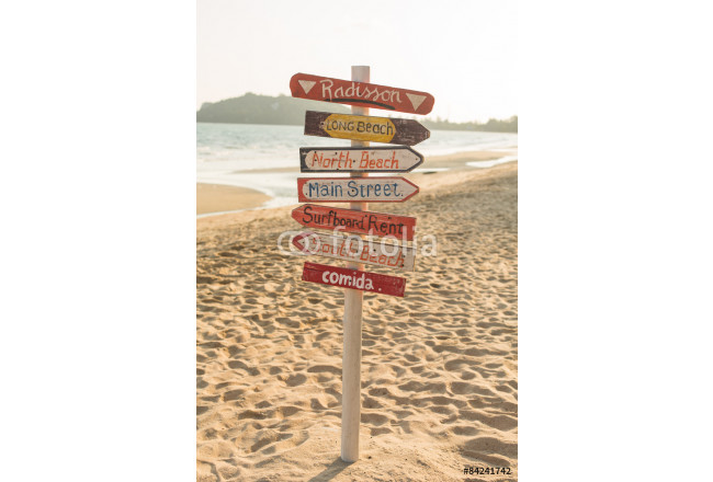 Signpost made of wood with the on the tropical beach. 64239